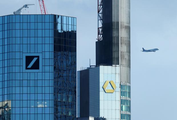 Tall order: Deutsche Bank and Commerzbank headquarters in Frankfurt where awareness of the obstacles to a deal are acute