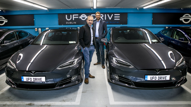 Stephen Morrissey and Renaud Marquet of UFODrive at the Tesla for Hire point in the Royal College of Surgeons car park in Dublin — the entire rental process is managed via an app