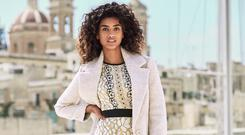 A model in Next clothes. The group's sales surged by 4.5pc in the past three months