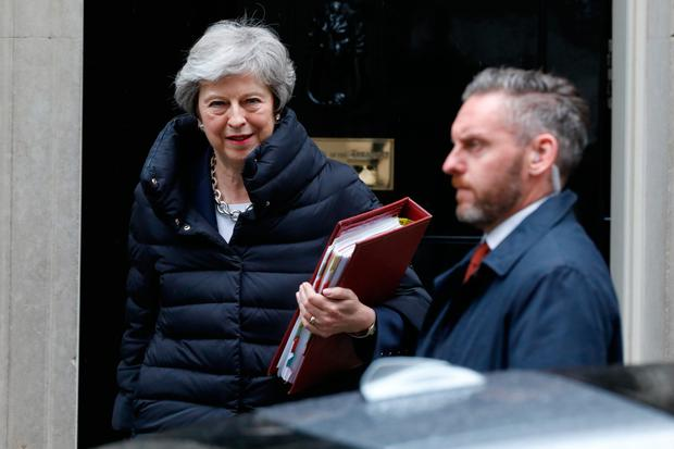 Out the door: Theresa May's Conservative Party is likely to suffer large losses in the upcoming European elections. Photo: Bloomberg