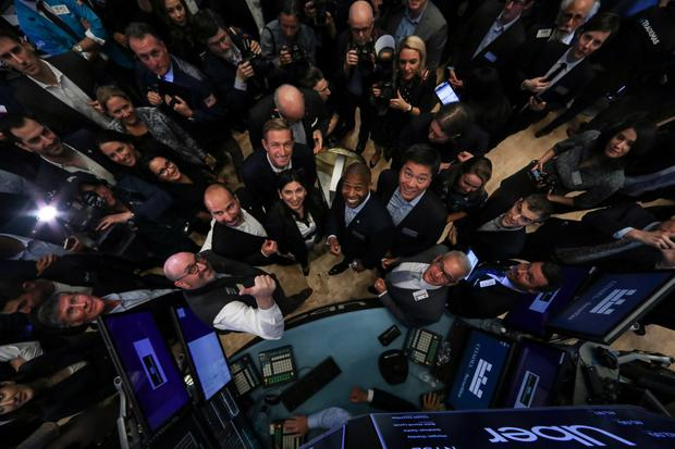 Bumpy ride: Uber CEO Dara Khosrowshahi, co-founders Ryan Graves and Garrett Camp, CFO Nelson Chai and NYSE president Stacey Cunningham pose together during the IPO on the floor of the New York Stock Exchange. Photo: Reuters