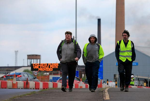 Blow: Workers leave British Steel's Scunthorpe plant in north Lincolnshire, north east England after the firm collapsed when last-ditch talks with its owners failed to secure a financial rescue. Photo: AFP/Getty Images