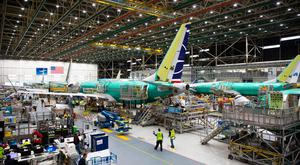 Grounded: Boeing has continued production of its troubled 737 Max jets as it aims to have the model recertified for flying within weeks