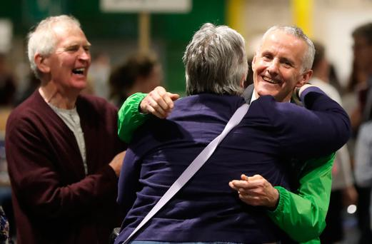 Crest of a wave: Green Party candidate Ciarán Cuffe (right) is greeted by well-wishers at the European election vote count at the RDS in Dublin. Photo: PA