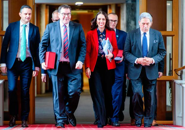 Financial planning: Prime Minister Jacinda Ardern and Grant Robertson, Finance Minister, centre left, are flanked by ministers James Shaw and Winston Peters as they head to present their budget. Photo: Bloomberg