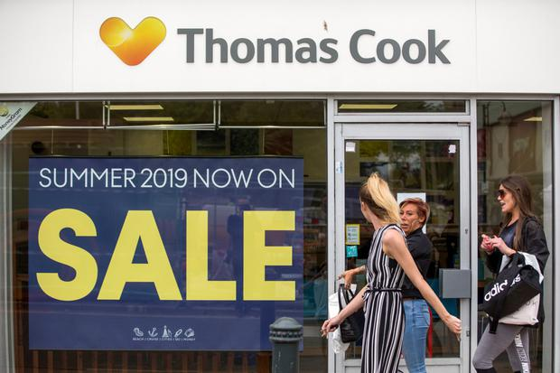 Feeling the heat: Thomas Cook stores like Three Bridges in England, were hit by a fall in last-minute bookings in 2018