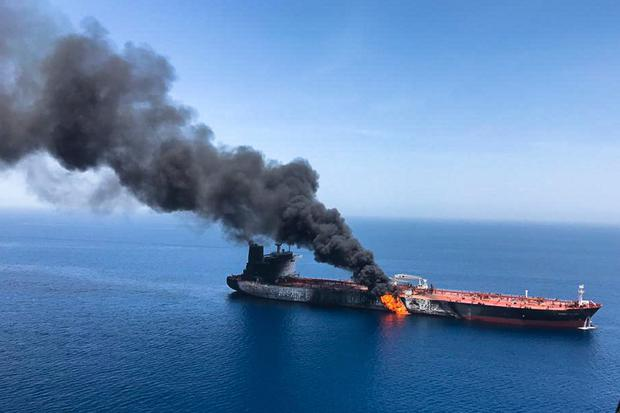 Dire Strait: One of the attacked oil tankers is seen on fire off the coast of Oman, near the strategic Strait of Hormuz, on Thursday. Photo: AP/ISNA