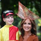 Clayton Cullen (6) in his Jocky colours looks at a specially commissioned headpiece worn by Lorraine Keane