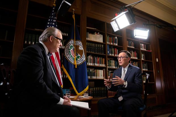 Richard Clarida, vice chairman of the US Federal Reserve, right, speaks during a Bloomberg Television interview in Washington