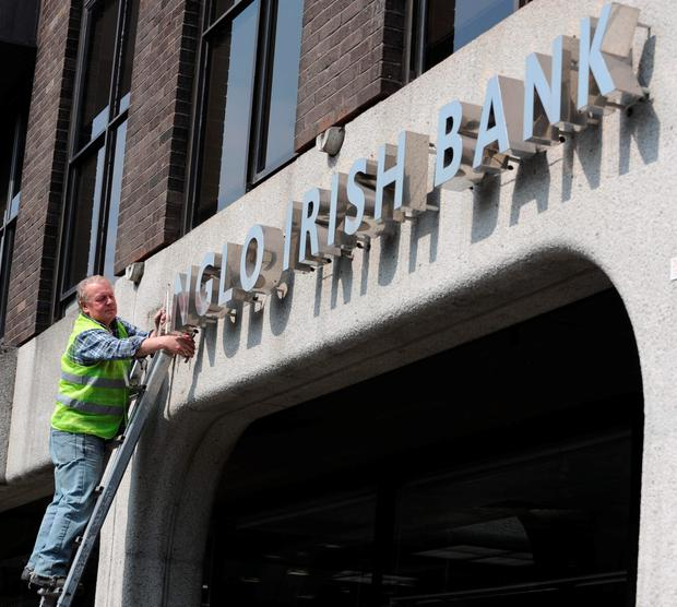 Sign of the times: Anglo Irish Bank's signage being removed at the height of the crisis
