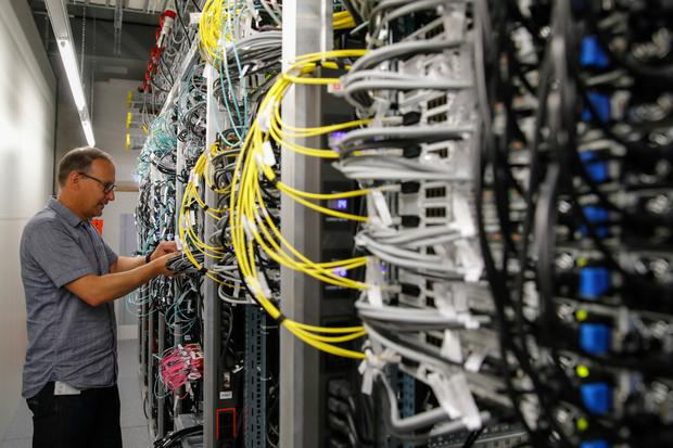 Connected: An engineer checks networking equipment in Swisscom's 5G network test platform in Bern, Switzerland. Photo: Bloomberg