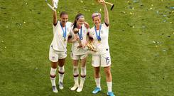 Field of dreams: (L-R) Alex Morgan, Rose Lavelle and Megan Rapinoe of the U.S. celebrate winning the Women's World Cup with their trophies. Photo: Reuters