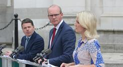 Concern: Tanaiste, Simon Coveney, centre, with Pascal Donohoe, Minister for Finance and Helen McEntee TD, Minister for European Affairs speaking to journalists at government buildings. Photo: INM