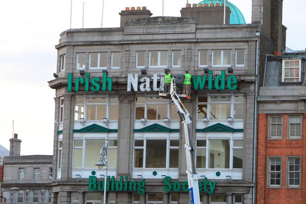 Sign-off: Workmen removing the Irish Nationwide signage in 2011. Photo: Collins