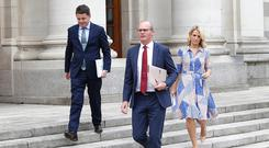 Tánaiste Simon Coveney, centre, with Paschal Donohoe, Minister for Finance, and Helen McEntee, Minister for European Affairs, after the release of the Government's updated Brexit contingency plan last Tuesday. Photo: Damien Eagers