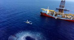 A helicopter flies near the Turkish drilling ship Fatih as it heads towards the eastern Mediterranean, near Cyprus. Turkish officials said ships would drill for gas, prompting protests from Cyprus. Photo: Turkish Defence Ministry via AP