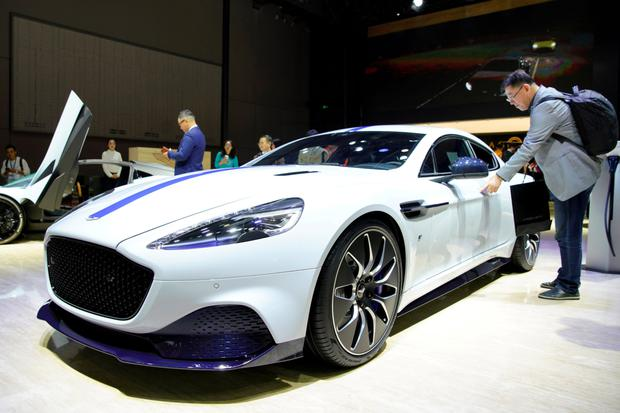 Bond-ing experience: A motoring enthusiast examines an Aston Martin Rapide E electric vehicle(EV) during the media day for Shanghai auto show in Shanghai, China. Photo: Reuters