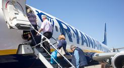 Passengers board a Ryanair flight at Dublin Airport