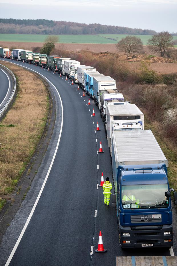 A tailback of trucks travelling to Dover as part of a trial last January of the UK's no-deal capabilities. Photo: Bloomberg