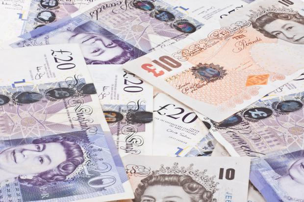 The battered pound took a breather, trading modestly lower, along with other so-called 'risky currencies', and still close to two and a half year lows against the dollar.