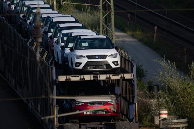 Growth stalls: New cars sit on railway wagons in Munich, Germany. The country's economy shrank in the second quarter