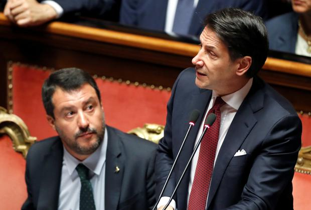 Moving on: Italian prime minister Giuseppe Conte, right, is to step down