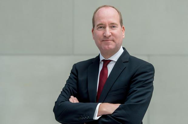 Threats: Joachim Lang of the BDI warned of a potential global recession
