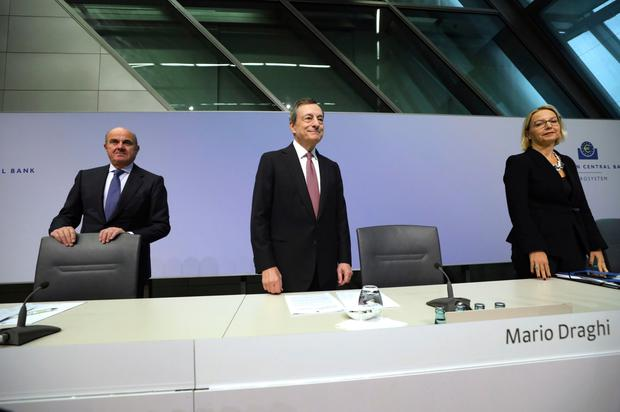 Rate minds: Mario Draghi, president, centre, with (left) Luis de Guindos, VP and Christine Graeff, director general for comms at the ECB news conference in Frankfurt on Thursday