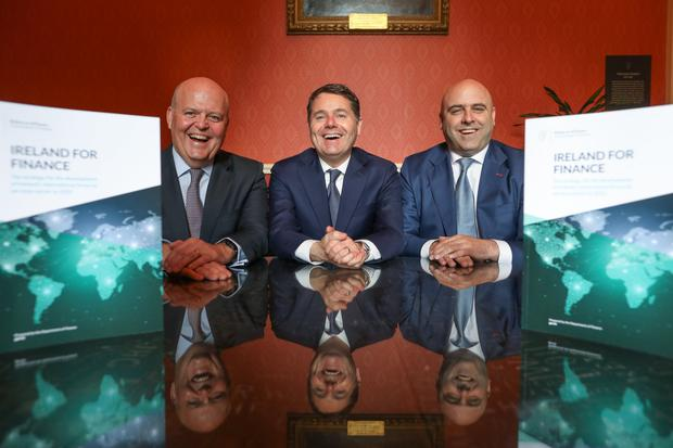 Stephen Nolan, chair of Climate Finance Week, right, with Minister for Finance Paschal Donohoe, centre, and Colin Hunt, CEO of AIB