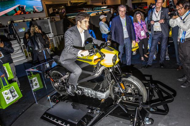Hog heaven?: An attendee on a Harley-Davidson LiveWire electric motorcycle at the 2019 Consumer Electronics Show in Las Vegas. Photo: David Williams/Bloomberg