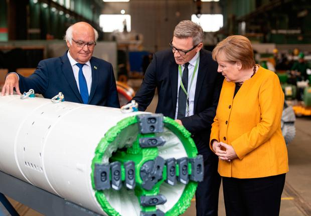 German leader Angela Merkel on a factory tour yesterday: Photo:AFP via Getty