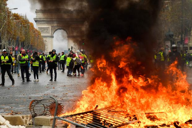 Unrest: The introduction of carbon taxes sparked riots in France