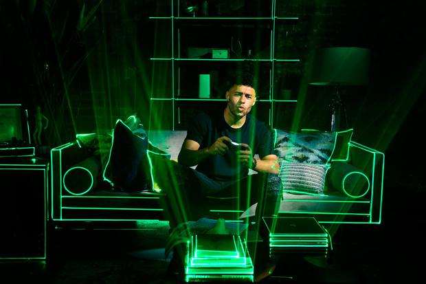 English footballer Alex Oxlade-Chamberlain is the first person to try out Three's new Call of Duty 5G experience in the UK. The operator has yet to dip its toes in the Irish 5G market. Photo: PA