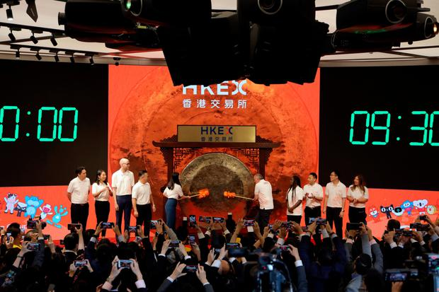 Take a bow: Officials of Alibaba take part in the ceremony as it launches on the Hong Kong stock exchange. Photo: Paul Yeung/Bloomberg