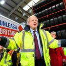 Election: British PM Boris Johnson dons a high-vis jacket on the campaign trail