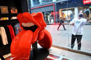 Start me up: Store assistants prepare for the opening today of the new Rolling Stones store