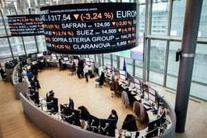 The Euronext NV Paris, above, and other global exchanges have endured virus-related volatility. Photo: Cyril Marcilhacy/Bloomberg