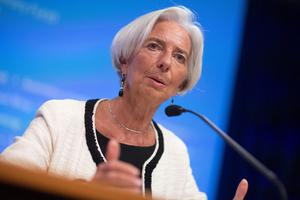 """Christine Lagarde, managing director of the International Monetary Fund (IMF), speaks at a news conference during the IMF and World Bank Group Annual Meetings in Washington, D.C., U.S., on Thursday, Oct. 9, 2014. The global response to the Ebola crisis is """"way behind the curve,"""" World Bank President Jim Yong Kim said today, as leaders of the three affected African nations appealed for financing and faster assistance. Photographer: Andrew Harrer/Bloomberg *** Local Caption *** Christine Lagarde"""