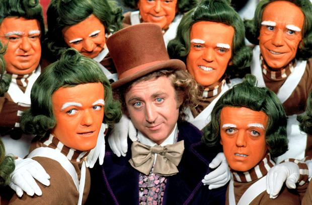 Gene Wilder as Willy Wonka with some of his Oompa-Loompas.