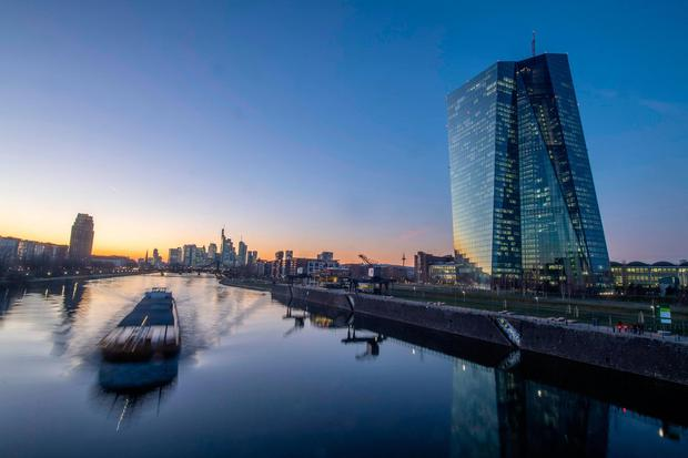 A barge makes its way on the river Main past the headquarters of the European Central Bank