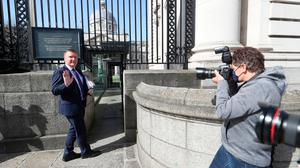 Minister for Public Expenditure, Michael McGrath, arrives at the Government Buildings in Dublin