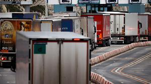 FILE PHOTO: Lorries queue at border control for the port of Dover after the end of the Brexit transition period, in Dover, Britain, January 15, 2021. REUTERS/John Sibley/File Photo