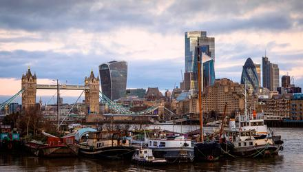 Rough seas ahead: Boats moored in front of skyscrapers in the City of London. Photo: Jason Alden/Bloomberg