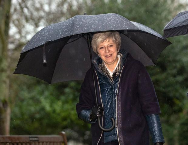 UK's May, facing defeat, to postpone Brexit vote