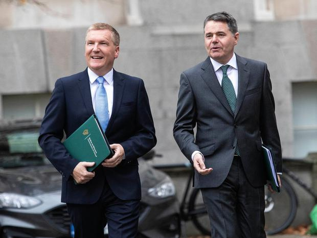 Minister for Finance Paschal Donohoe (right) and Minister for Public Expenditure and Reform Michael McGrath arriving at Government Buildings, Dublin PA Photo
