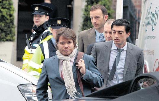 Members of the 'Troika' team - European Commission, ECB and IMF - crossing the street from the Merrion Hotel to the Department of Finance in 2012