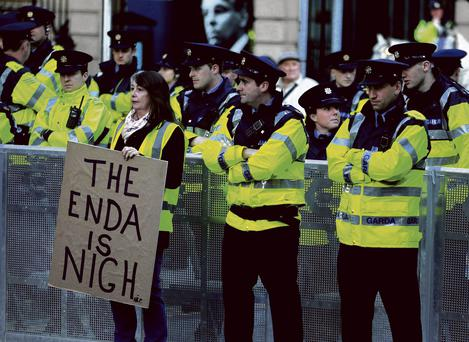 Protesters surrounded by gardai outside Leinster House as Michael Noonan delivered Budget 2014