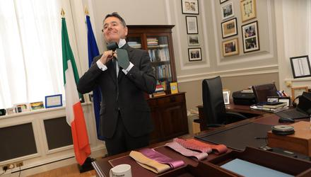 Finance Minister dons a tie before heading to the Dáil for his Budget Day speech. Photo: Julien Behal.