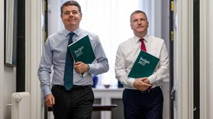 Finance Minister Paschal Donohoe delivering Budget 2021 with Public Expenditure and Reform Minister Michael McGrath. Photo: Gerry Mooney