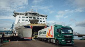 Haulage trucks disembark from the Stena Estrid roll-on/roll-off passenger and freight cargo ship, operated by Stena Line AB, as it arrives from Ireland, at the Port of Cherbourg in France. Photographer: Cyril Marcilhacy/Bloomberg